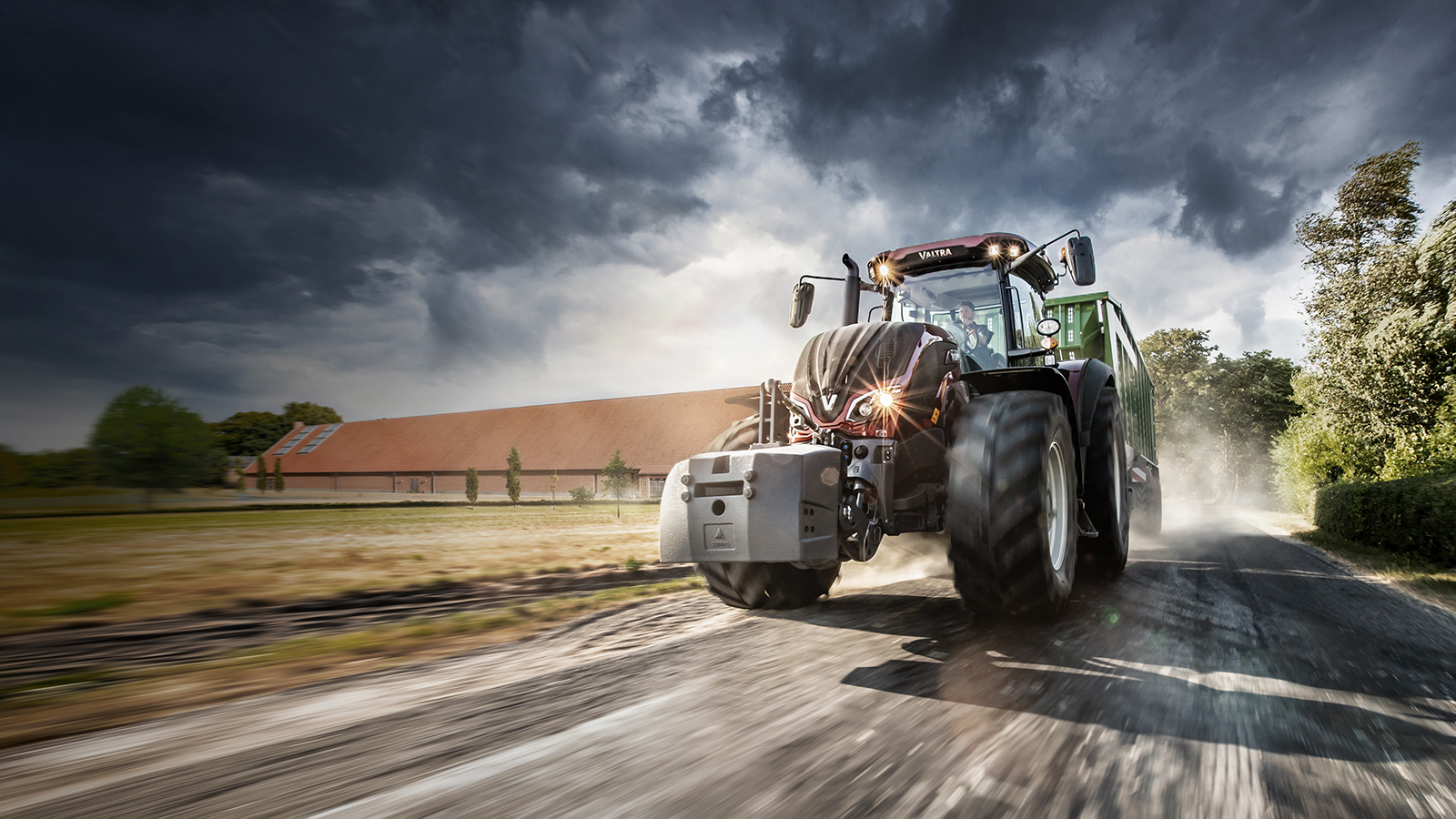 Valtra S Series red driving on the road