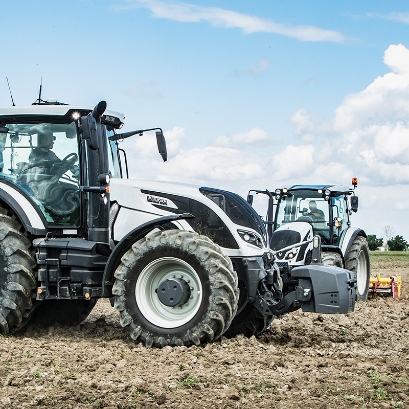 Valtra tractors on field